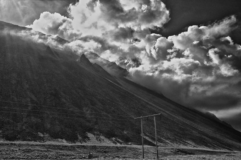 Volcanic Slope and Morning Clouds