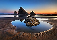 Nikon D80, F/11, 3/4 sec, ISO 100, Sigma 10-20mm @ 14mm, 3-stop GND, Post-processing in Topaz Adjust Location: Silver Point, Oregon To get down low enough to have part of the background rocks in reflection, I had my tripod legs almost horizontal, with the center column jammed into the sand.