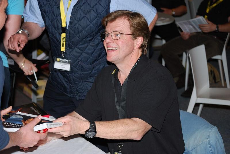 Joe McNally signing books.
