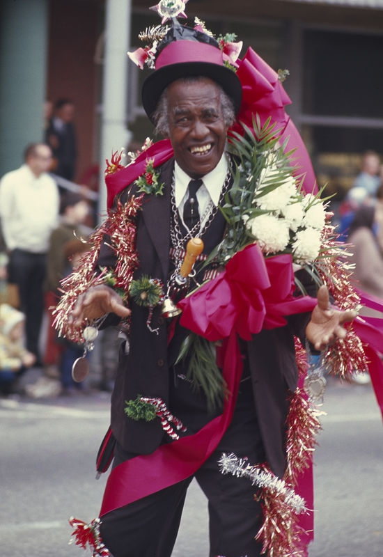 Man with flowers at Thanksgiving parade