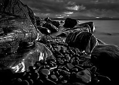 Late afternoon light on rocks at Low Head, Northern Tasmania, Australia.