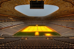 Stadium near Munich at night with the grow-light installation turned on. Natural light through the roof-opening ist not sufficient to keep the grass alive.