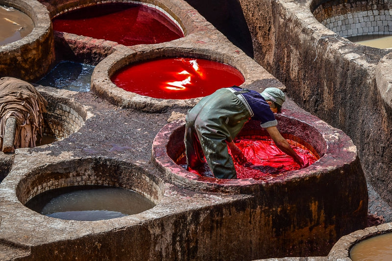 Dye worker in tannery at Fes