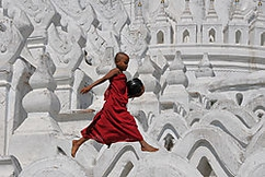 Novice monk having a little fun at the Hsinbyume Pagoda in Mingun, Burma. Taken in December, 2008. Equipment used: D300, Nikkor 18-200mm VR lens at 65mm, f/14, 1/800 sec., ISO 200, handheld, no filters.