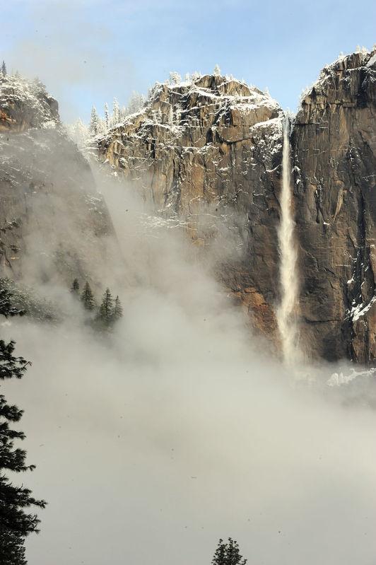 Fog-filled Yosemite Falls from Swinging Bridge