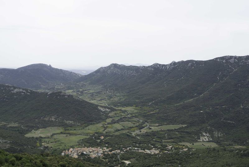 The_Corbieres_from_Chateau_Peyrepertuse_Chateau_Queribus_in_the_Distance.jp