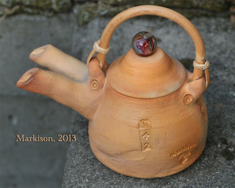 T42: Handthrown double-spouted teapot, flameworked marble top