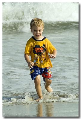Garrick racing the waves